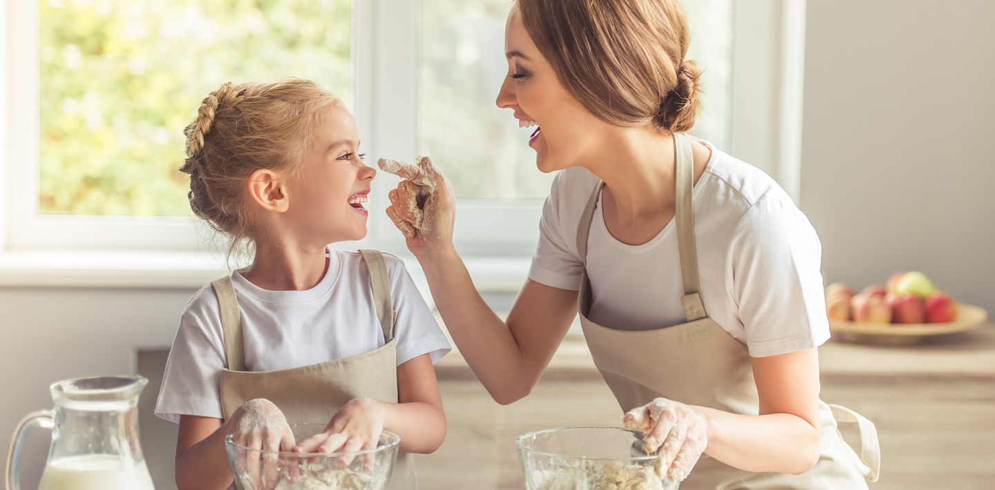 Mom and daughter bake together.