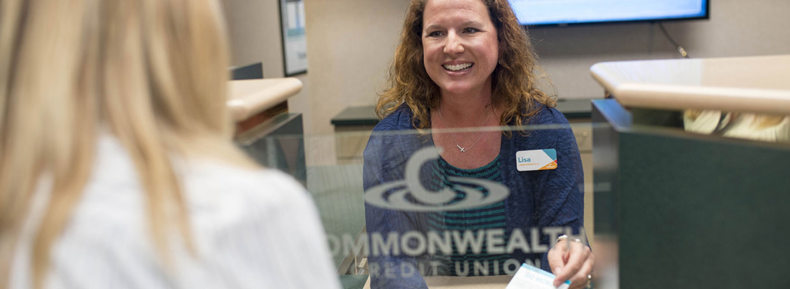 A CCU employee smiles at a member.